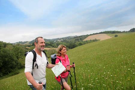 Senior couple hiking in natural landscape photo