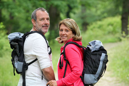 rambling: Portrait of smiling hikers in forest pathway