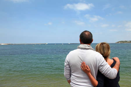 Senior couple enjoying sea view photo