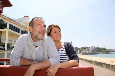 Senior couple in seaside resort looking at the beach photo