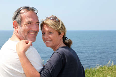 Cheerful senior couple relaxing on vacation photo