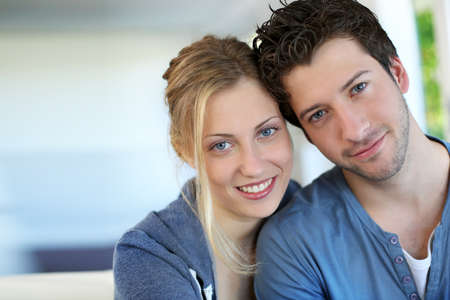 Closeup of cheerful young couple wearing blue photo