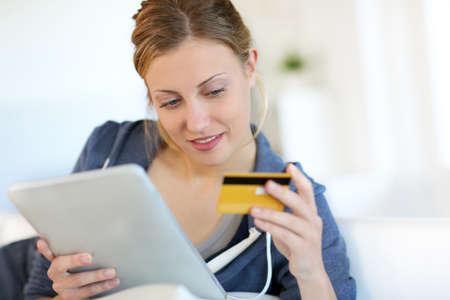 Closeup of beautiful blond girl doing online shopping Stock Photo - 14113447