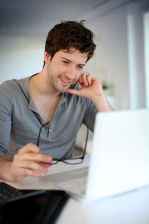 Young man studying from home photo