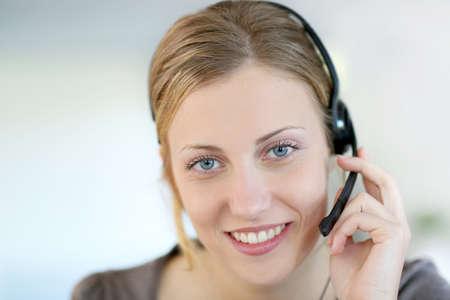 teleoperator: Closeup of beautiful blond teleoperator
