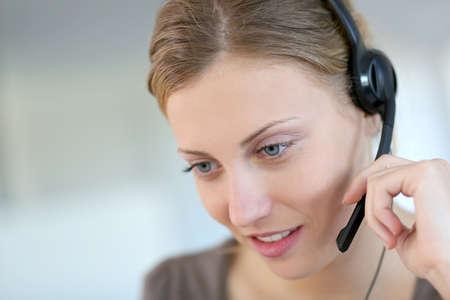 teleconference: Closeup of beautiful blond teleoperator