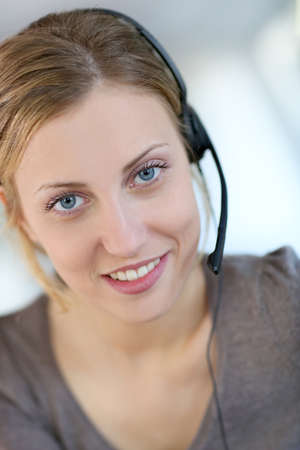Closeup of beautiful blond teleoperator photo
