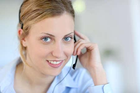 teleoperator: Closeup of attractive blond customer service assistant Stock Photo