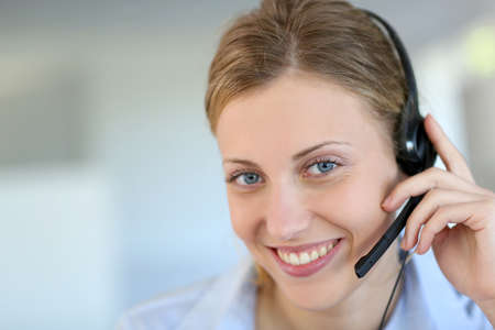 teleconference: Closeup of attractive blond customer service assistant Stock Photo