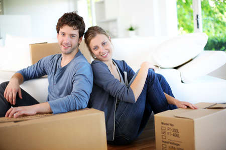 Young couple moving in their home photo