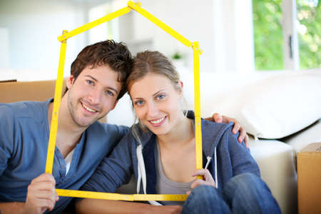 Portrait of happy young property owners photo