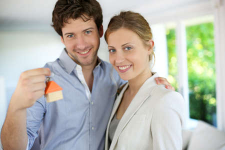 housing loan: Closeup of happy new property owners Stock Photo