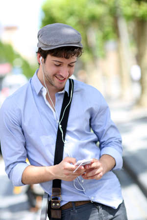 mobilephone: Young trendy guy talking on mobilephone in the street