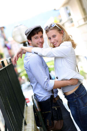 Young in love couple embracing each other in town photo