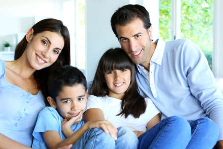 latin mother: Family relaxing in sofa at home Stock Photo