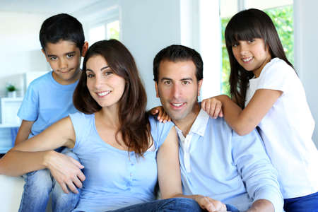 latin girls: Family relaxing in sofa at home Stock Photo