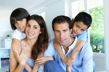 Family relaxing in sofa at home photo