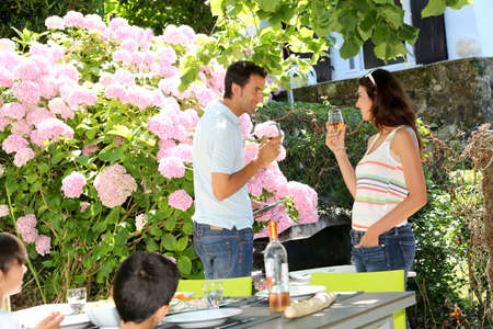 Parents cheering with wine on barbecue day photo