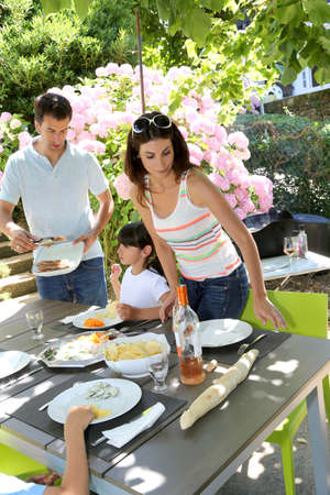 Father serving grilled meat to family Stock Photo - 14663694