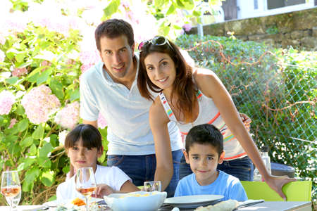 family garden: Closeup of happy family having lunch in garden