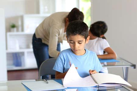 Children in class with teacher photo