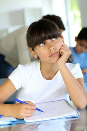 Young school girl with bored look on her face Stock Photo - 14663564