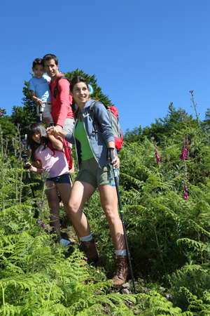 rambling: Family on a hiking day going down hill
