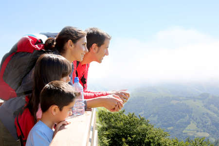 Family on a trek day in the mountain looking at the view photo
