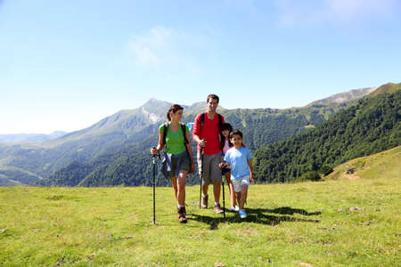 rambling: Family on a trekking day in the mountains
