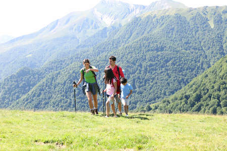 Family on a trekking day in the mountains photo