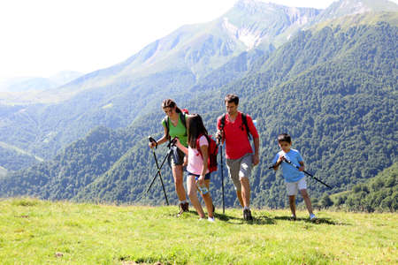 hikers: Family on a trekking day in the mountains
