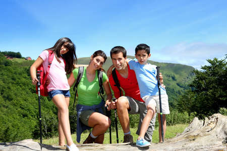 latin kids: Portrait of family on a trekking day in the moutain Stock Photo