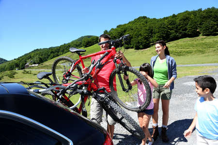 recreational: Family preparing bicycles for recreational journey