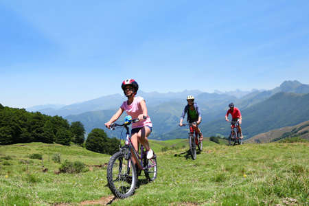 latin woman: Family riding bikes in the mountains Stock Photo