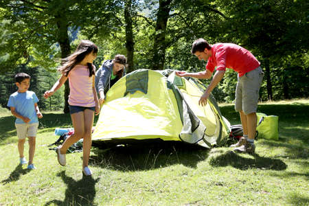 latin kids: Family doing camping in the forest