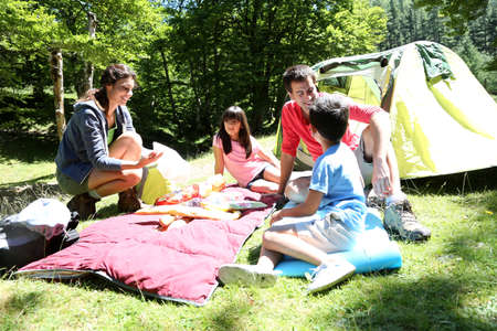 camping equipment: Family doing camping in the forest