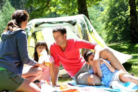 Family doing camping in the forest photo