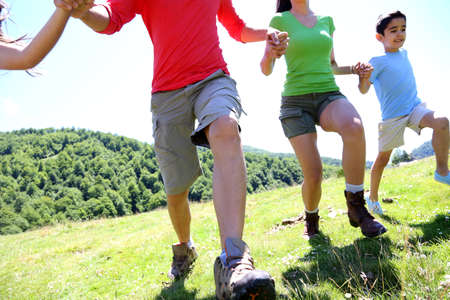 Happy family enjoying and running together in the mountains Stock Photo - 14663683