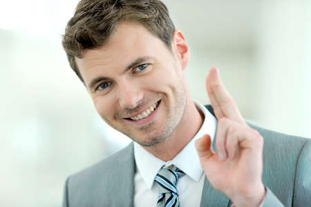 Portrait of cheerful businessman with successful and happy look photo