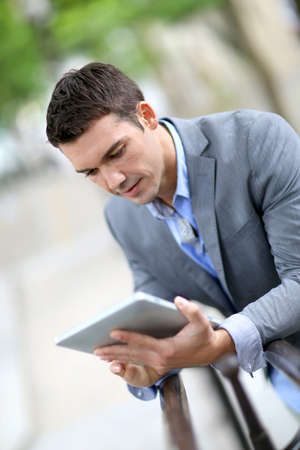 Man using electronic tablet outside in town Stock Photo - 14663788