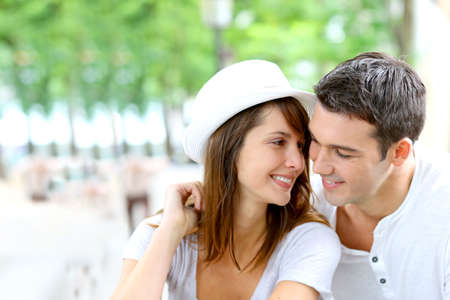 Lovers looking at each other with romantic look photo