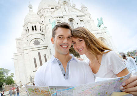 Couple in Montmartre reading tourist map photo