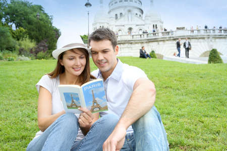 Couple in Paris sitting in front of Sacre Coeur Basilica photo
