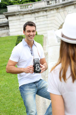 Man taking picture of girlfriend during journey photo