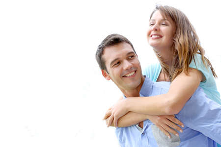 couple dating: Man carrying girlfriend on his back, isolated