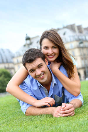 In love couple laying in public park Stock Photo - 14663818
