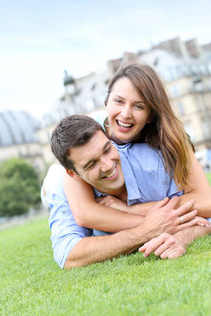 lovers park: In love couple laying in public park Stock Photo