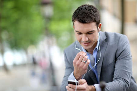 hands free device: Businessman in the street talking on the phone