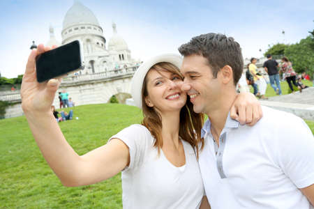 coeur: Lovers taking picture of themselves in front of Sacre Coeur  Stock Photo