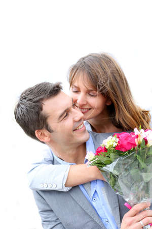 Portrait of romantic man giving flowers to woman Stock Photo - 14679421